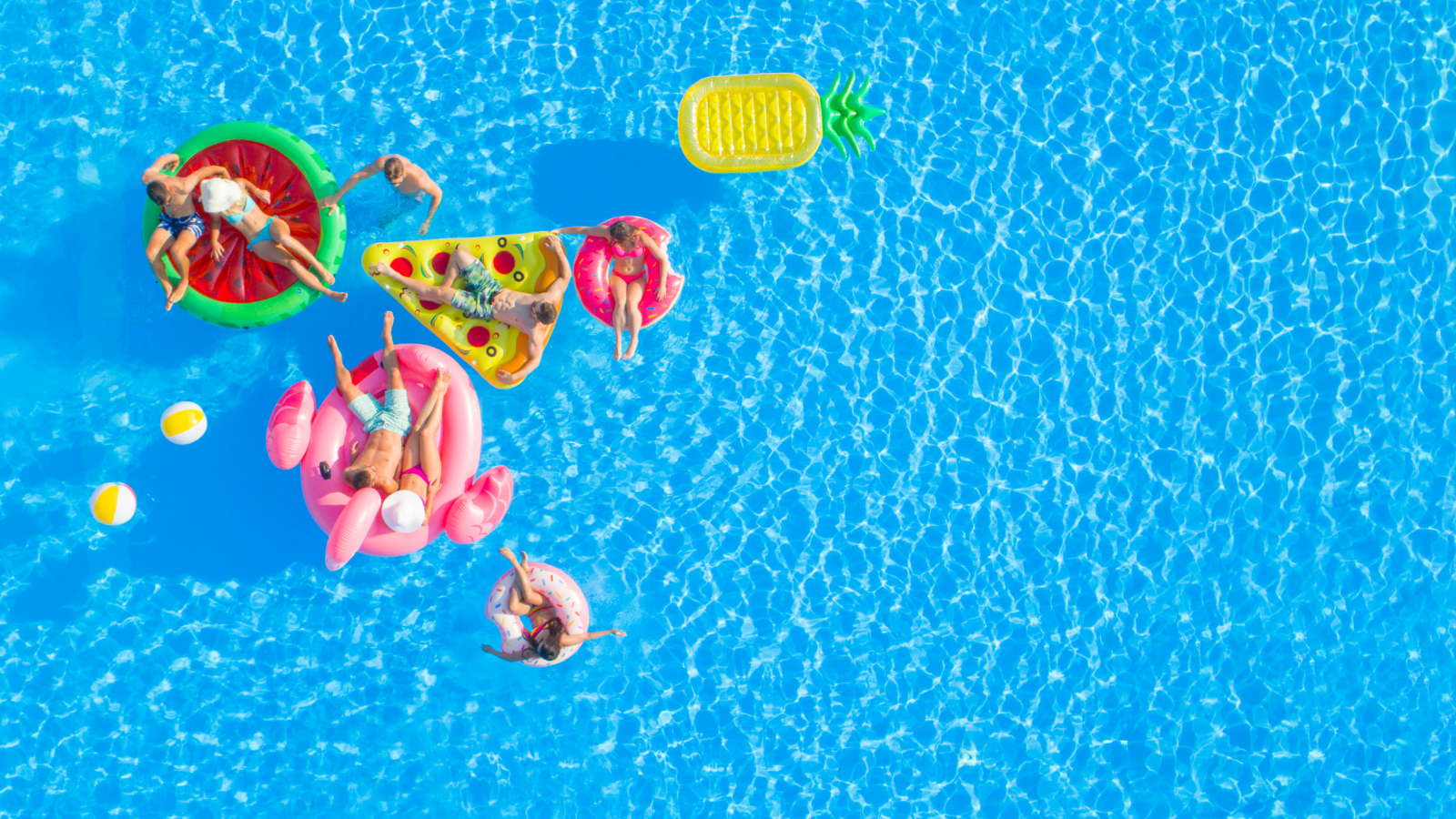 People laying on pool floats